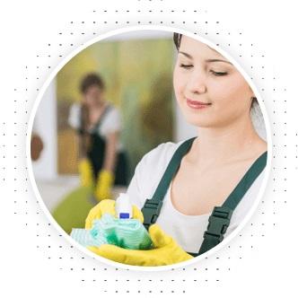 girl wearing rubber gloves holding spray bottle and green rag