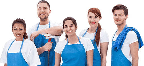 Two men and three woman in blue aprons standing together and smiling