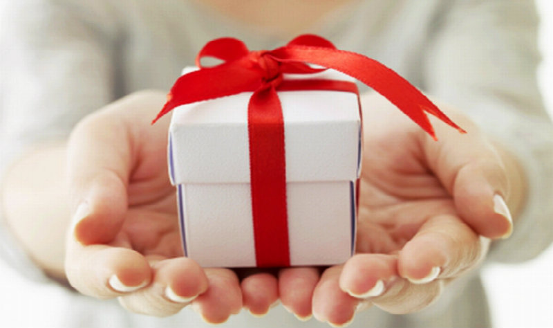 beautiful hands holding a gift
