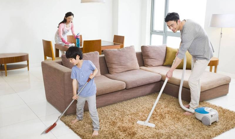 Entire family making efforts to make their house tidy