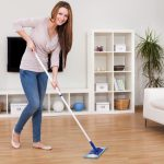 young woman wiping the floor with a wiper