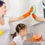 young mother and daughter sprucing up their bathroom