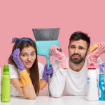worried couple with some chemicals and disinfectants