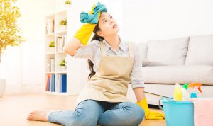 young woman looking stresses about house cleaning