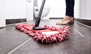 cropped picture of a woman moping the bathroom floor